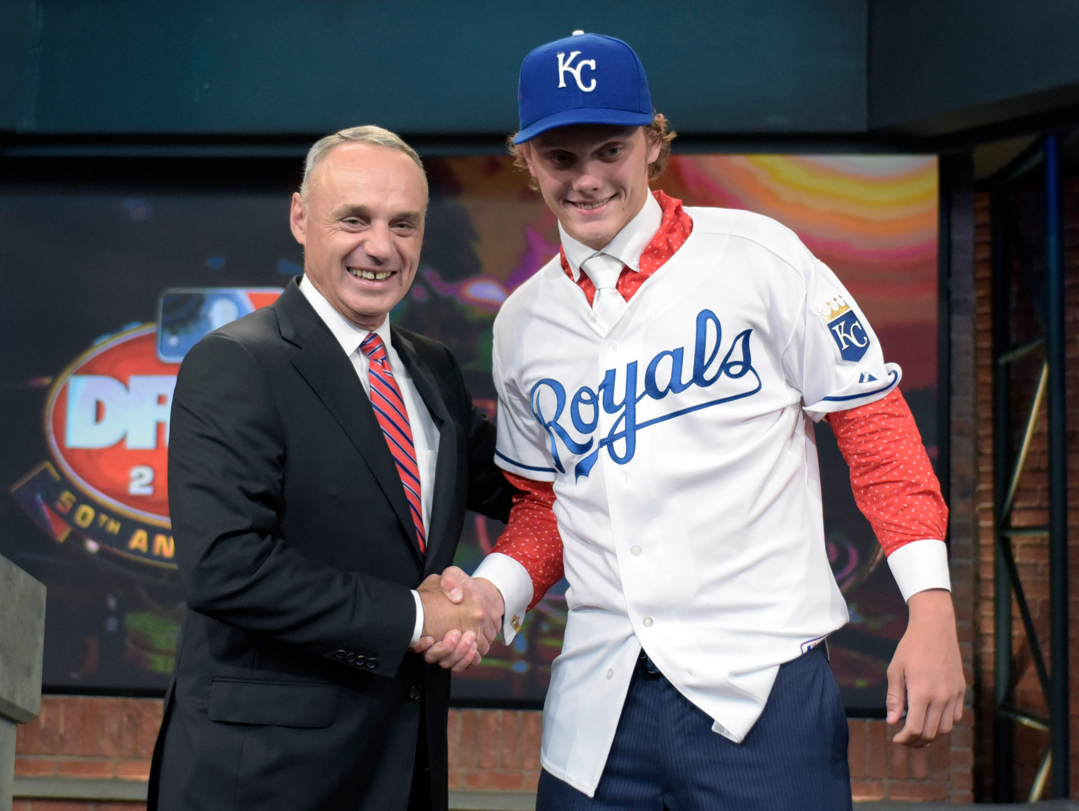 Commissioner of Major League Baseball Rob Manfred, left, poses with pitcher Ashe Russell from Cathedral High School in Indianapolis, Ind., at the 2015 MLB baseball draft Monday, June 8, 2015, in Secaucus, N.J. Whitley was chosen by the Kansas City Royals with the 21st selection.
