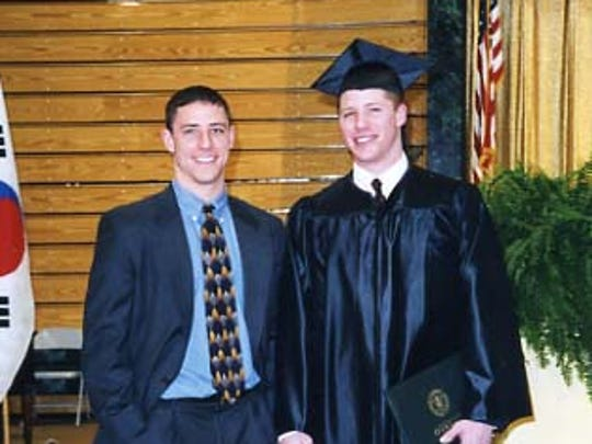 John, left, and Bob Nally shown here at Bob's graduation from SUNY Oswego. John went to the University of Rochester. Both played college soccer.
