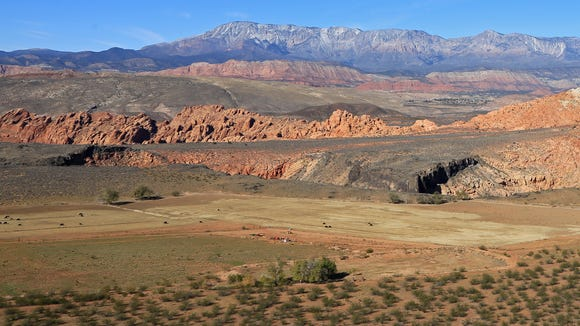 The West Cinder Knoll Trail in the Red Cliffs Desert Reserve north of Hurricane culminates in this view of the Babylon area and the Pine Valley Mountains.