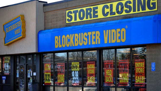 FILE - This March 17, 2010, file photo, shows a closing Blockbuster stores in Racine, Wis. Dish Network announced Wednesday, Nov. 6, 2013, it will close the remaining 300 Blockbuster locations scattered across the United States. Dish Network expects the stores to be closed by early January. Dish Network says about 2,800 people will lose their jobs. (AP Photo/Journal Times, Scott Anderson, File) ORG XMIT: WIRAC201
