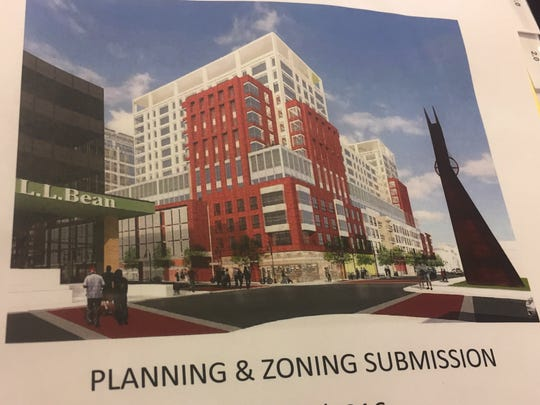 An artist's rendering of the proposed redevelopment of Burlington Town Center is shown on the cover page of a planning and zoning permit application. Photographed Dec. 16, 2016.