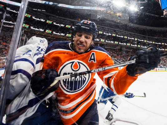 Toronto Maple Leafs' Nikita Zaitsev (22) is checked by Edmonton Oilers' Milan Lucic (27) during the second period of an NHL hockey game, Thursday, Nov. 30, 2017 in Edmonton, Alberta. (Jason Franson/The Canadian Press via AP)