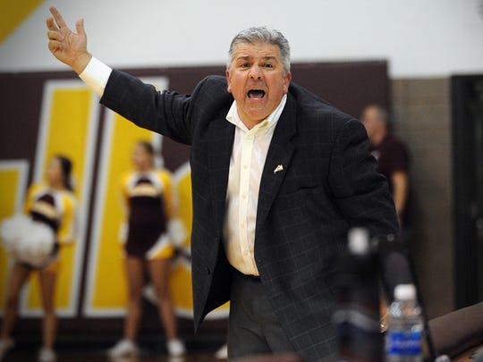 Salisbury head coach Andy Sachs argues a call in a
