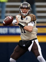 Nov 27, 2015; Toledo, OH, USA; Western Michigan Broncos quarterback Zach Terrell (11) looks to pass during the second quarter against the Toledo Rockets at Glass Bowl. Broncos win 35-30. Mandatory Credit: Raj Mehta-USA TODAY Sports
