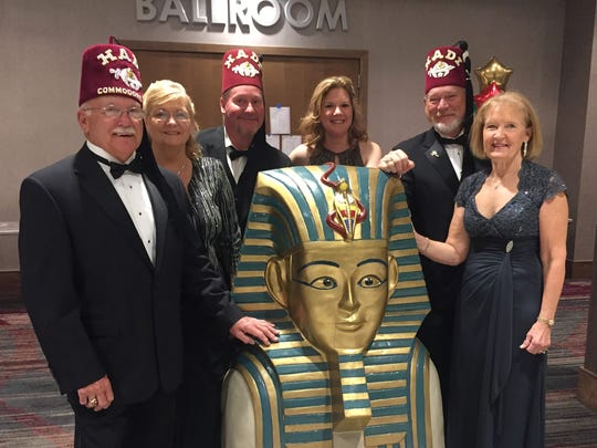 Potentate Ball The new downtown Double Tree was the location of the Hadi Shrine 2017 Potentate Ball. The ballroom was gorgeous with guests formally attired and a sea of red with all the gentlemen in their fezes. We caught up with  Commedore Dave Horn and his Lady Kayla, Vice Commedore Sam Byers and Lady Andrea and Treasurer Mike Sollman and Lady Yonetta posing at the entry of the ballroom.