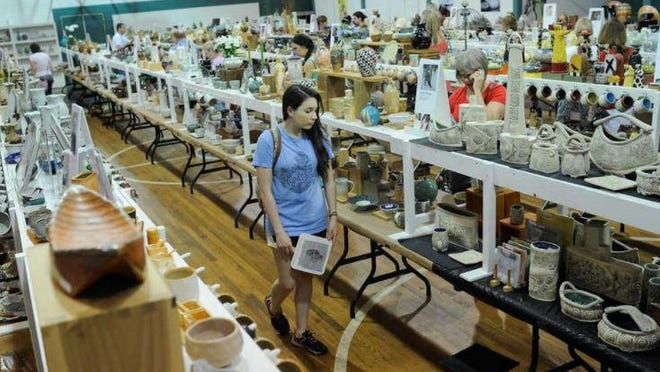 A scene from a previous Perspectives pottery show, where potters put thousands of pieces on sale at OCAF in Watkinsville.