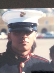 Marco Chavez was in the Marines for four years. Here he is with his mother, Alicia, at his graduation from boot camp.