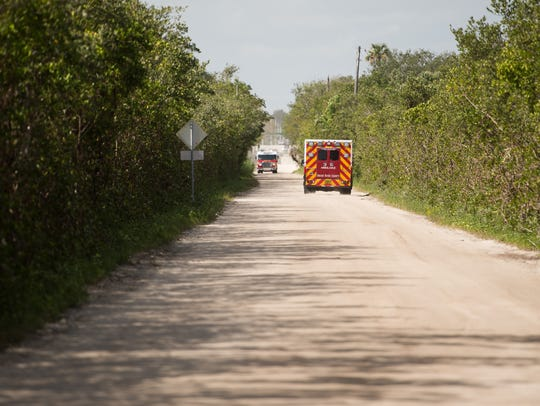 Vehicles pass each other on the unpaved section of
