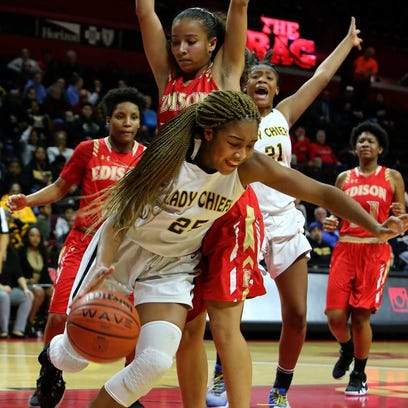 Piscataway's Yamirah Bennett drives along the baseline