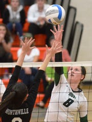 Novi's Victoria Iacobelli (8) tips a shot over Northville's