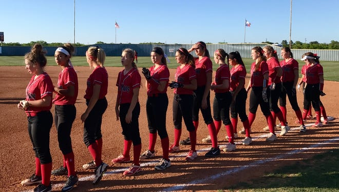 The Eastland Lady Mavericks line up along the first base line in Hawley as the Colorado City Lady Wolves are introduced before Game 2 of the best-of-three Region I-3A area playoff series Friday, May 4, 2018. Eastland won the game 5-4, forcing a third and decisive game later that night.