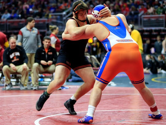 Elijah Van't Hof of Sioux Center wrestles Tyler LinderBaum