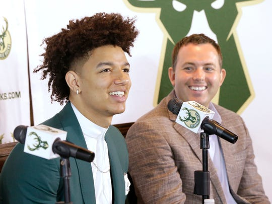 D.J. Wilson (left), the Milwaukee Bucks' first-round NBA draft pick, is introduced to the media at a news conference Monday, June 26, 2017. New Bucks GM Jon Horst (right) was at his side.