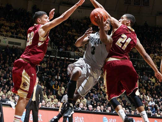 Purdue Boilermakers guard Ronnie Johnson goes up for a shot in between Boston College Eagles guards Lonnie Jackson and Olivier Hanlan at Mackey Arena.