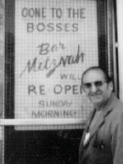 Sam Sniderman stands in front of his store, Sniderman's Hardware.