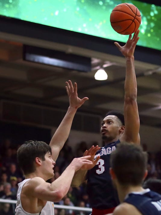 Gonzaga's Johnathan Williams, right, shoots over San Francisco's Erik Poulsen during the second half of an NCAA college basketball game Saturday, Jan. 13, 2018, in San Francisco. (AP Photo/Ben Margot)