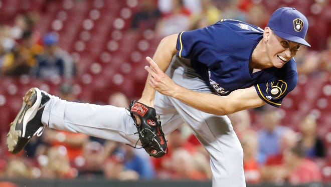 Milwaukee Brewers relief pitcher Brent Suter throws in the eighth inning of a baseball game against the Cincinnati Reds, Monday, Sept. 12, 2016, in Cincinnati. The Reds won 3-0.