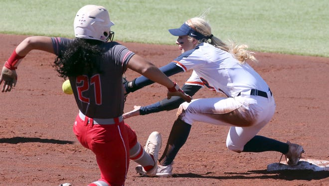 UTEP second baseman Courtney Clayton, right, gets the throw in time to force out Adarian Gray of Western Kentucky Saturday at Helen of Troy softball complex.