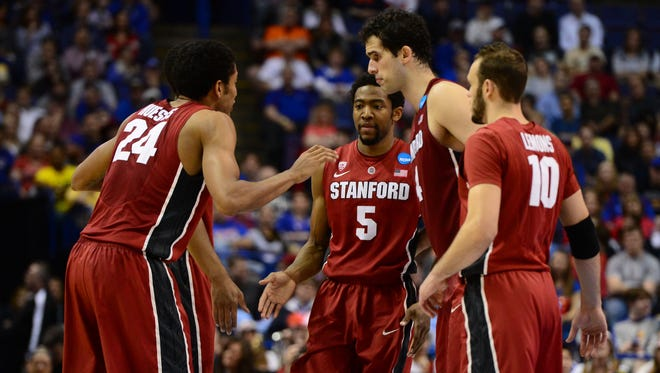Stanford Cardinal guard Chasson Randle (5) reacts with teammates in the second half against the New Mexico Lobos.