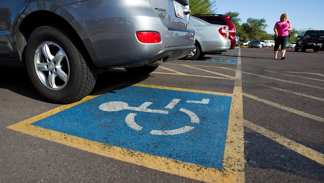 Cars parked in handicapped parking spaces at the Costco store in Paradise Valley.