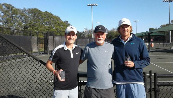 Men's open doubles winners Hayden Essary (far left) and Brock Sakey (right) with Bruce Caton (center) director of tennis at Roger Scott Tennis Center after the duo won the men's open division at the annual Pensacola Adult Clay Court Championships.
