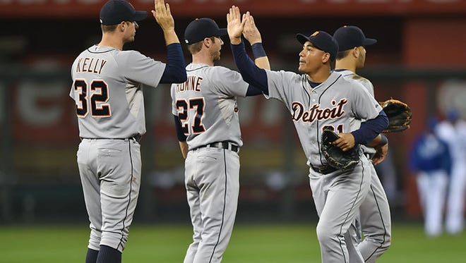 The Tigers celebrate after the 10-1 win Friday in Kansas City, Mo.