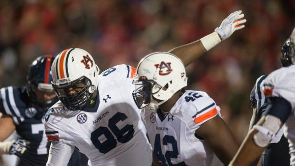 Auburn defensive lineman DaVonte Lambert points in his direction as a play was ruled touchdown which was later overturned and it was ruled that Auburn recovered a fumble in the end zone. Auburn defeated Mississippi 35-31