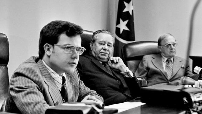 Public Service Commissioner Bob Clement, left, voices his opposition to an order allowing South Central Bell Telephone Co. a $16.5 million annual revenue increase, while Commissioners Z.D. Atkins, center, and Cayce Pentecost listen to his argument during their meeting at the Cordell Hull Building Dec. 24, 1973. But Commissioners Atkins and Pentecost approved the increase.