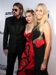 Billy Ray Cyrus, with his famous daughter, Miley, and
