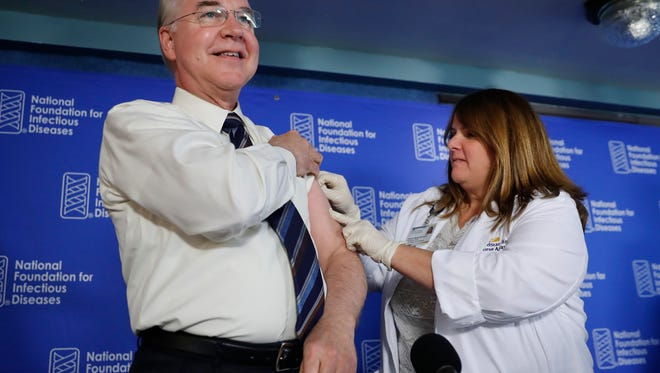 Health and Human Services Secretary Tom Price receives a flu vaccination from Sharon Walsh-Bonadies during a news conference Sept. 28, 2017, recommending everyone age 6 months and older be vaccinated.