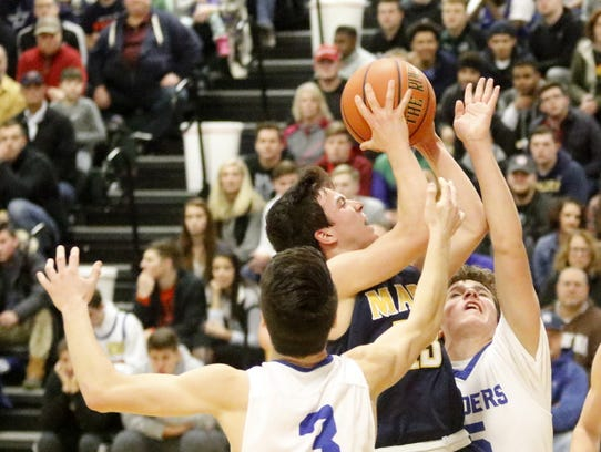 Andrew Recchia of Mars goes up for a shot as Horseheads'