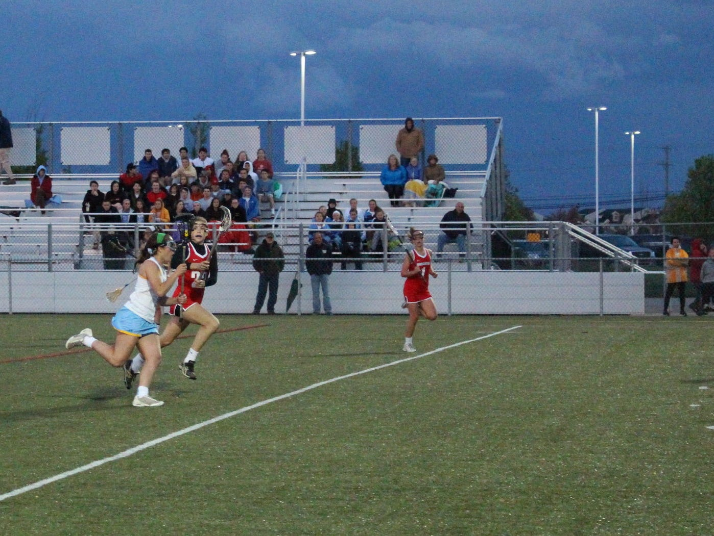 Cape freshman midfielder Katie Frederick runs the ball up field.