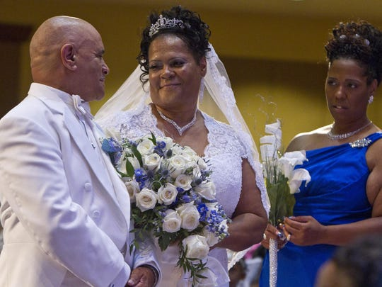Theresa and Dennis Watson renew their wedding vows at the Cavalry Lighthouse Church after 30 years of marriage. Both are cancer survivors, and Theresa wanted the opportunity to walk down the isle to marry her husband.