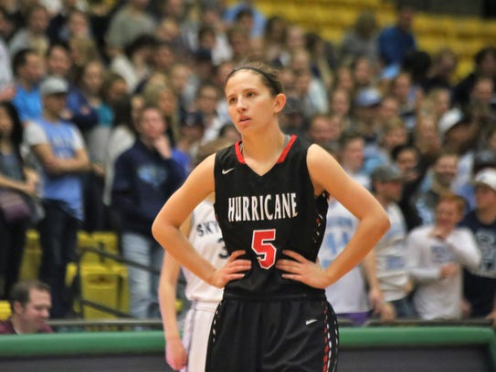 Hurricane's Kylee Stevens reacts to call during the
