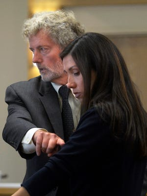In this Monday, Sept. 26, 2016, photo, Barie Goetz, the state's crime scene reconstructionist, left, uses special prosecutor Elicia Montoya to explain a bullet trajectory to the jury during the trial of police detective Keith Sandy and Dominique Perez in the shooting death of homeless camper James Boyd in District Court in Albuquerque.