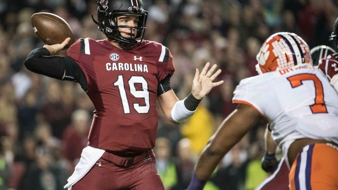 FILE - In this Nov. 25, 2017, file photo, South Carolina quarterback Jake Bentley (19) attempts a pass against Clemson defensive end Austin Bryant (7) during the first half of an NCAA college football game, in Columbia, S.C. South Carolina coach Will Muschamp says Bentley is expected to start against No. 22 Texas A&M after missing last week's game with a left knee injury. Muschamp says Bentley has practiced well and unless there's a setback will go against the Aggies on Saturday. (AP Photo/Sean Rayford, File)