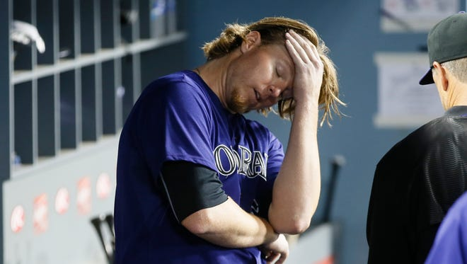 Colorado Rockies starting pitcher Jon Gray reacts in the dugout after being pulled from the game against the Los Angeles Dodgers during the fifth inning of a baseball game, Monday, Sept. 14, 2015, in Los Angeles. (AP Photo/Danny Moloshok)