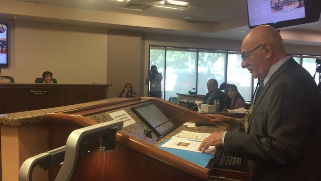 Richard Dayoub, who served as chairman for the advisory committee, presents charter election recommendations to the City Council on Tuesday.