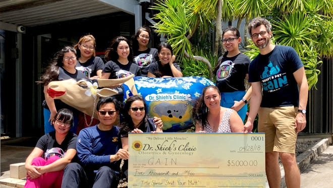 Dr. Shieh's Clinic donates $5,000 to our furry friends at GAIN. Top row from left: Jocelyn Mesngon, Maria Evangelista, Reinalyn Perez, Carina Valera, Cristy Malabanan, Grace Salamera, Cyrus Luhr. Bottom row from left: Rochelle Ebeo-Pangilinan, Dr. Thomas Shieh, Raven Shieh, Ana Babauta.