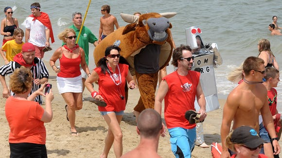 "The annual Running of the Bull draws thousands to Dewey Beach each year to watch see a ""bull fight"" with a celebrity matador at the end of the run."