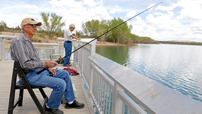 Jim Lujan, of Farmington, waits for a fish to bite on May 4 at the dock at Farmington Lake.