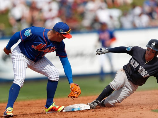 New York Yankees' Ronald Torreyes, right, beats the tag from New York Mets second baseman Asdrubal Cabrera (13) to steal second base in the fourth inning of a spring training baseball game Wednesday, March 7, 2018, in Port St. Lucie, Fla. (AP Photo/John Bazemore)