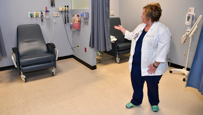 Pam Crues shows an area where patients with less serious ailments can be see in a a chair instead of sitting on a bed just for a routine check of vital signs.Nashville General Hospital has renovated their ER so people with less serious problems go on a different track from the really sick/emergency people.Thursday Oct. 19, 2017, in Nashville, TN