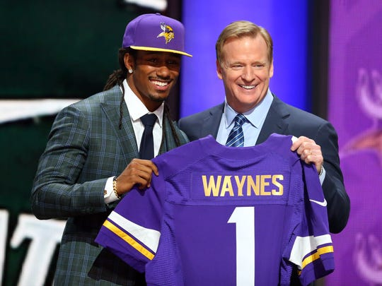 Trae Waynes (Michigan State) greets NFL commissioner Roger Goodell after being selected as the number 11 overall pick to the Minnesota Vikings in the first round of the 2015 NFL Draft at the Auditorium Theatre of Roosevelt University.