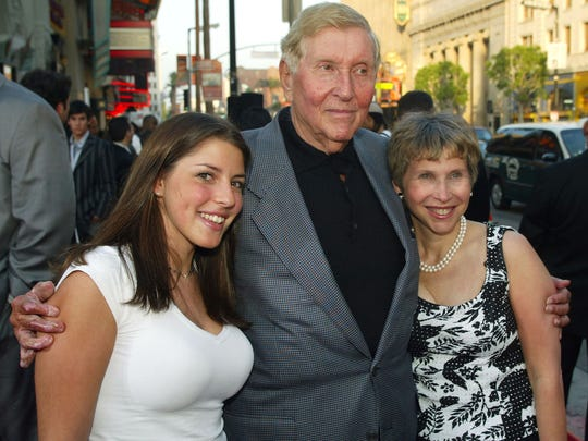 "Viacom's Sumner Redstone arrives with daughter Shari, right, and grandaughter Kim for the premiere of ""The Italian Job"" at the Chinese Theater on May 27, 2003, in Los Angeles."