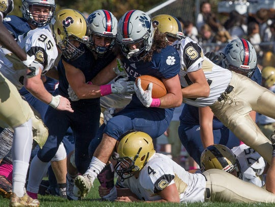Lacey's Jason Giresi pushes through the middle of line