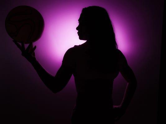 Silhouette Of Girl Sspinning Basketball On Finger