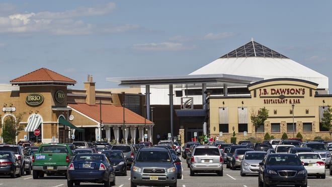 Vehicles park at Christiana Mall on July 31. State transportation officials are closely monitoring traffic volumes on the last weekend before the holiday.