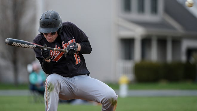 Palmyra's Evan Hallowell ducks out of the way of a high ball as Palmyra defeated Northern Lebanon 7-4 at Northern Lebanon on Thursday, March 31, 2016.