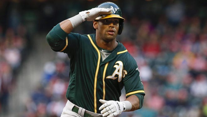 Khris Davis was traded by the Brewers to the A's for minor-league prospects Jacob Nottingham and Bubba Derby.